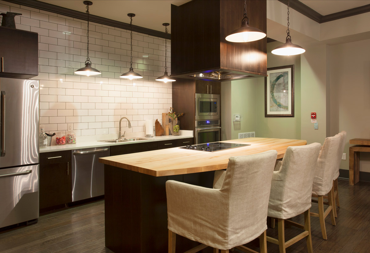 Modern Kitchen with Stainless Appliances at Riverhouse Apartments in Little Rock, Arkansas