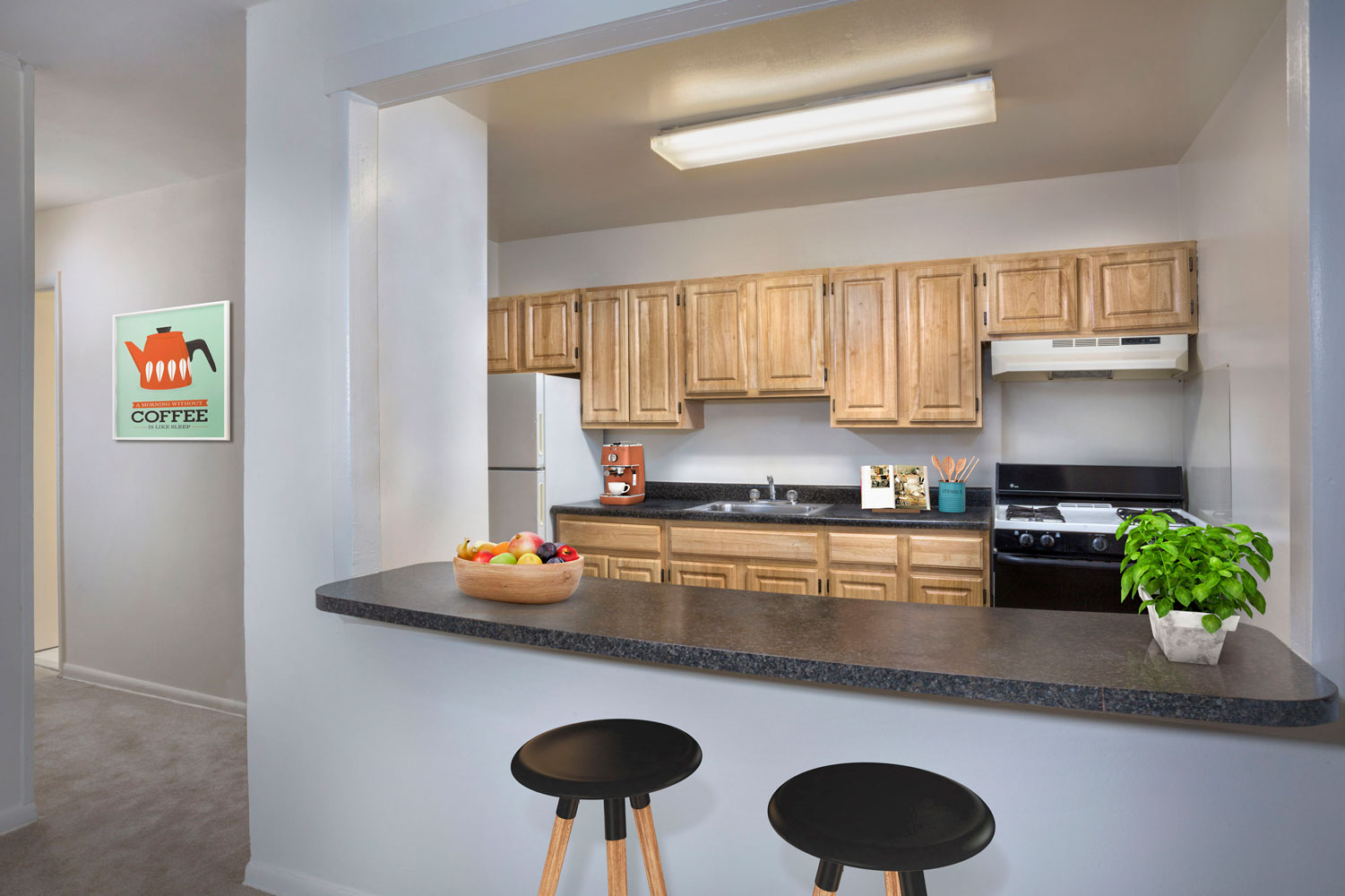 Kitchen with breakfast bar at Riverside Plaza Apartments in Oxon Hill, MD