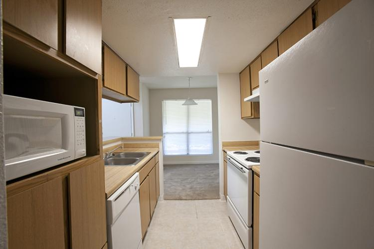 Kitchen at The Riverwalk Apartments in Houston, TX