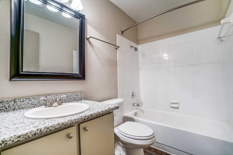 Refined Bathrooms at Riviera Apartments in Dallas, Texas