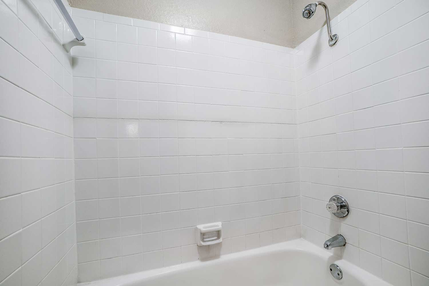 Bathtub and Shower at Riviera Apartments in Dallas, Texas
