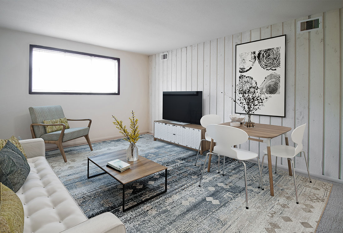 Living Room with Accent Wall at Pinehill Park Apartments in Bellevue, NE