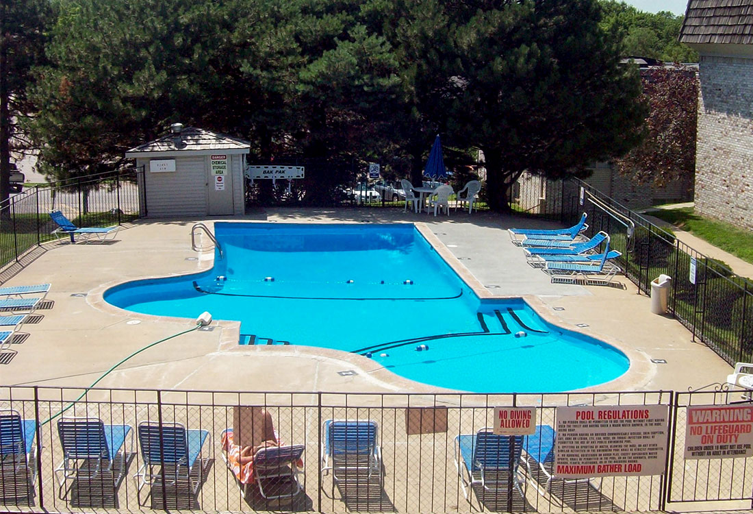 Swimming Pool with Sun Deck and Lounge Furniture at Pinehill Park Apartments in Bellevue, NE