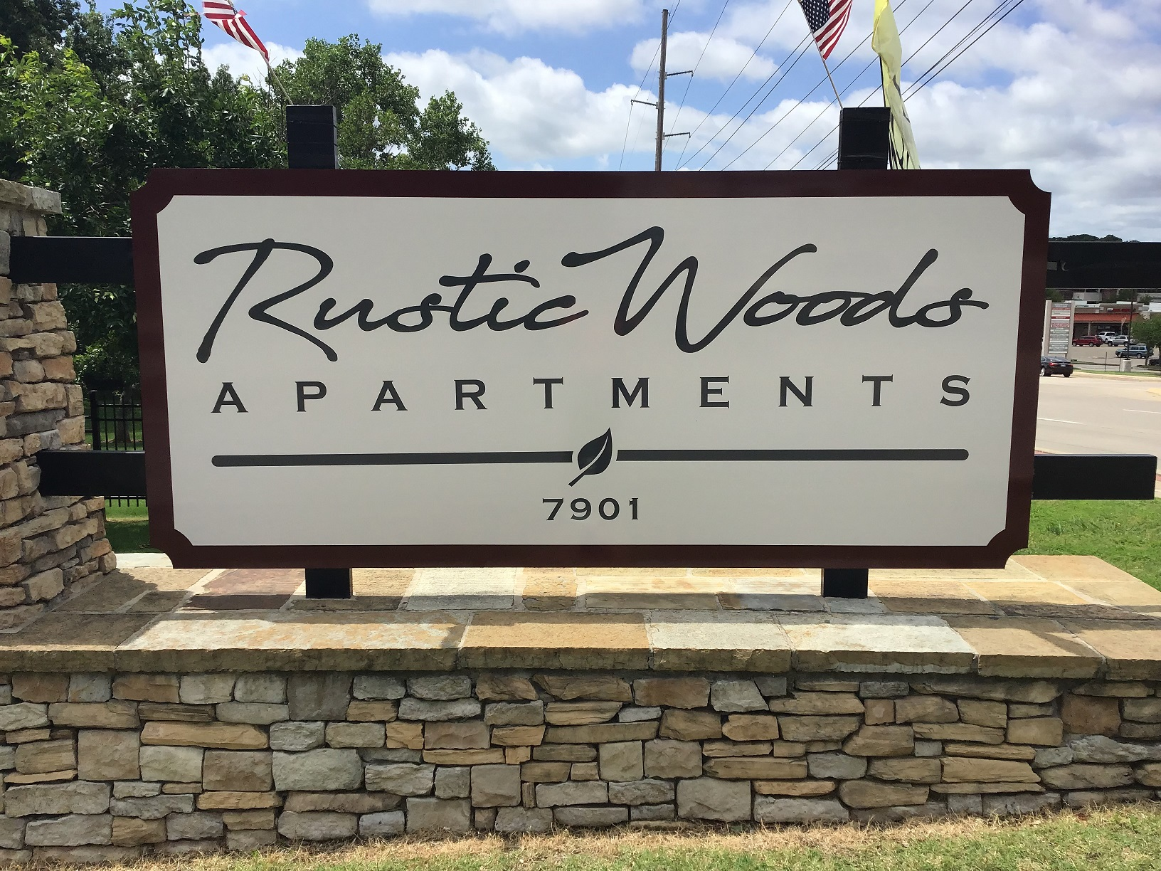 Welcoming Signage at Rustic Woods Apartments in Tulsa, Oklahoma