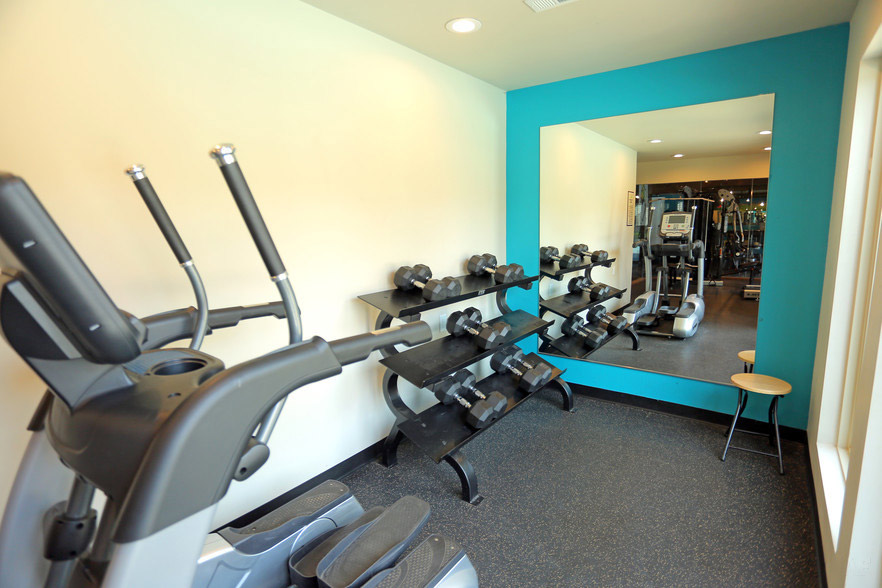 Weights and Cardio Equipment at Rustic Woods Apartments in Tulsa, Oklahoma