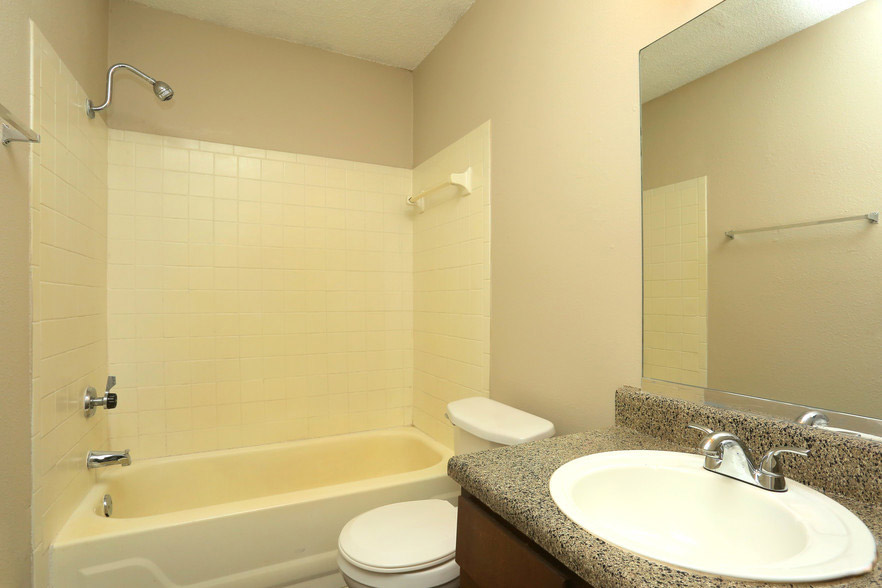 Shower and Bathtub Combination at Rustic Woods Apartments in Tulsa, Oklahoma