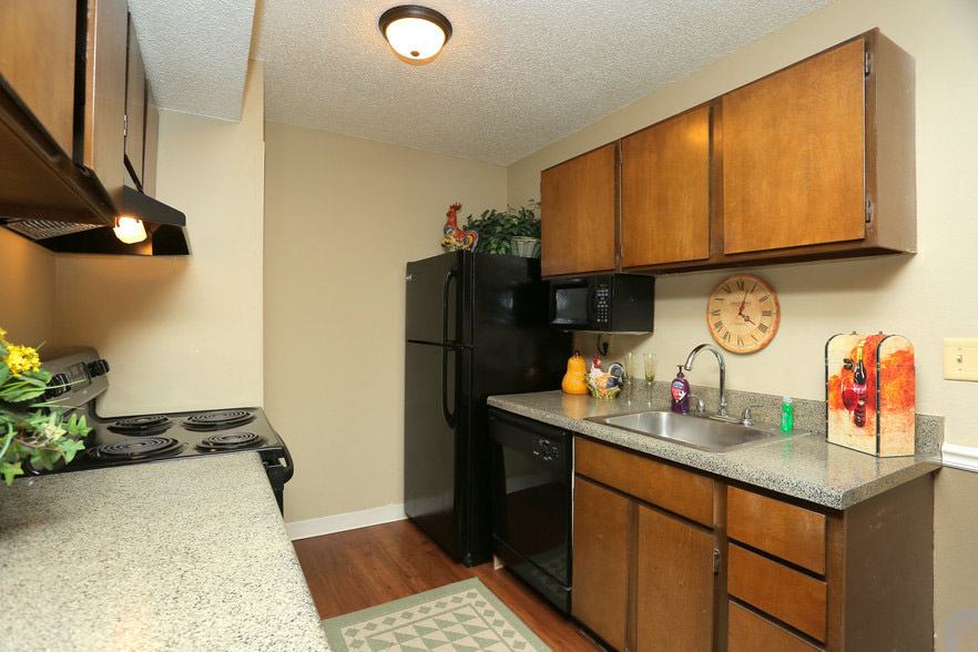 Fully-Equipped Kitchen at Rustic Woods Apartments in Tulsa, Oklahoma