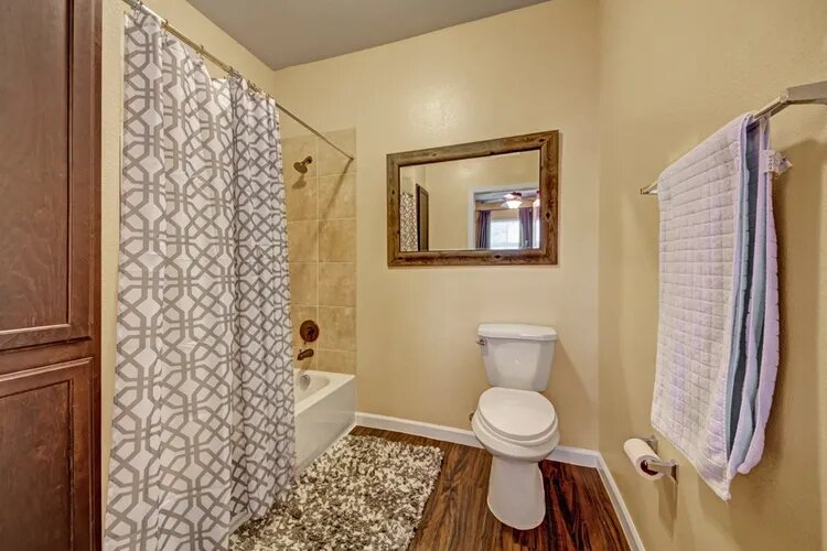 Spacious Bathroom with Shower and Tub Combo at The Savannah at Gateway Apartments in Plano, Texas