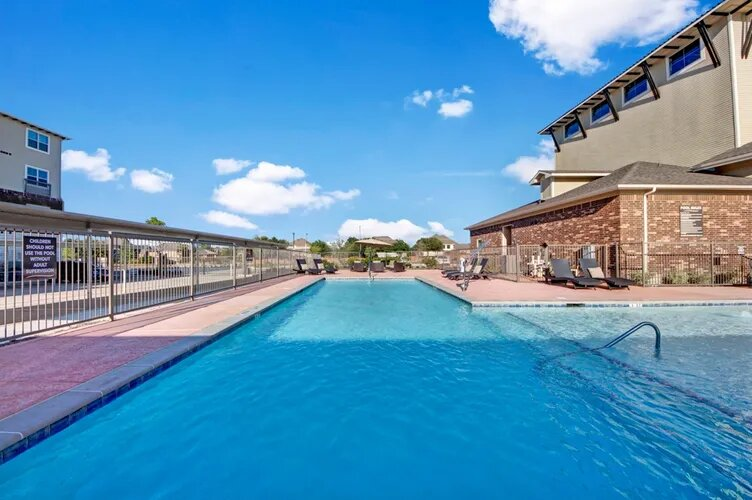 Shimmering Swimming Pool at The Savannah at Gateway Apartments in Plano, Texas