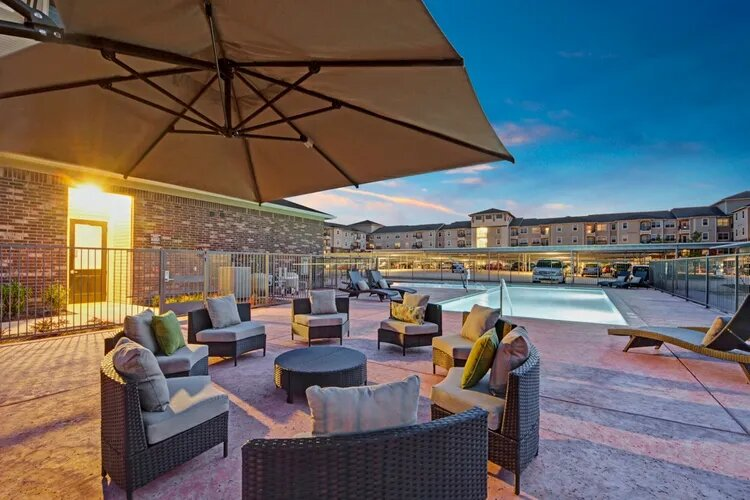 Poolside Lounge Area at The Savannah at Gateway Apartments in Plano, Texas