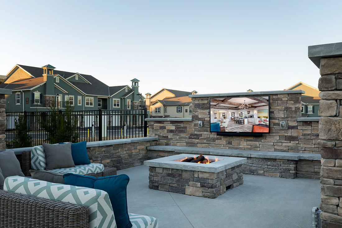 Outdoor Living Room with Fire Pit at Savannah West Apartments in Kansas City, MO
