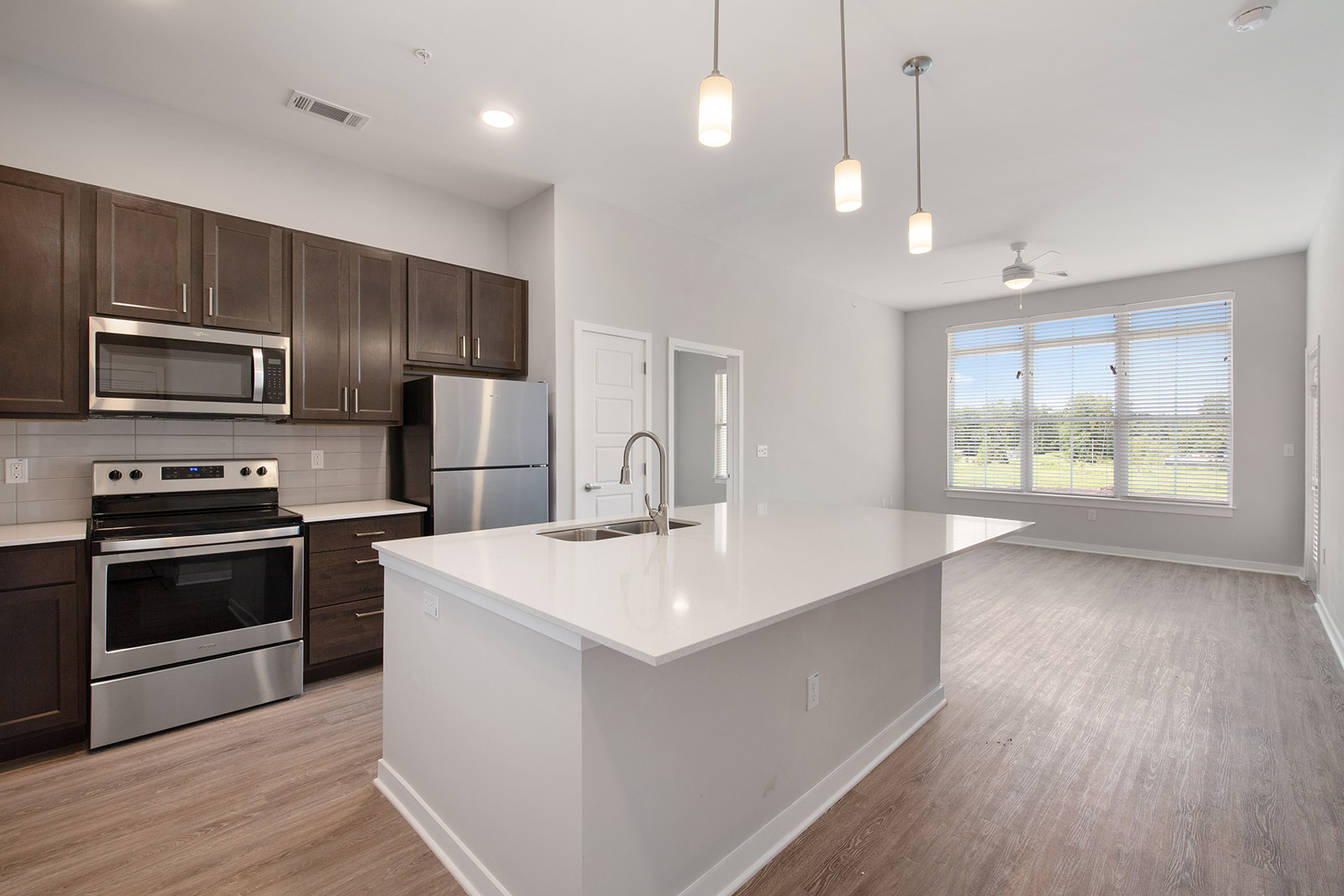 Modern Lighting in Kitchen at Sawgrass Point in Gonzales, Louisiana