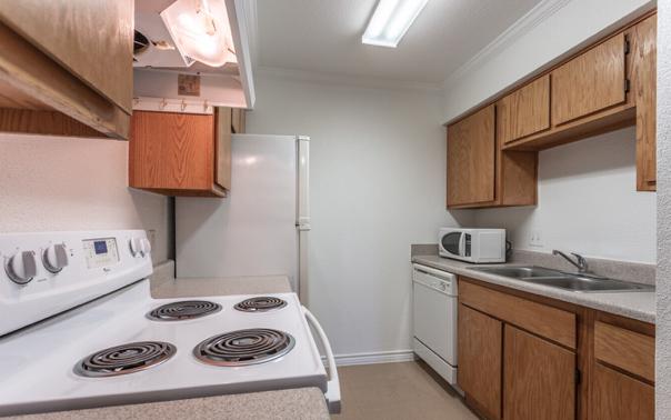 Kitchen at Seaport Village Apartments in Galveston Island, TX