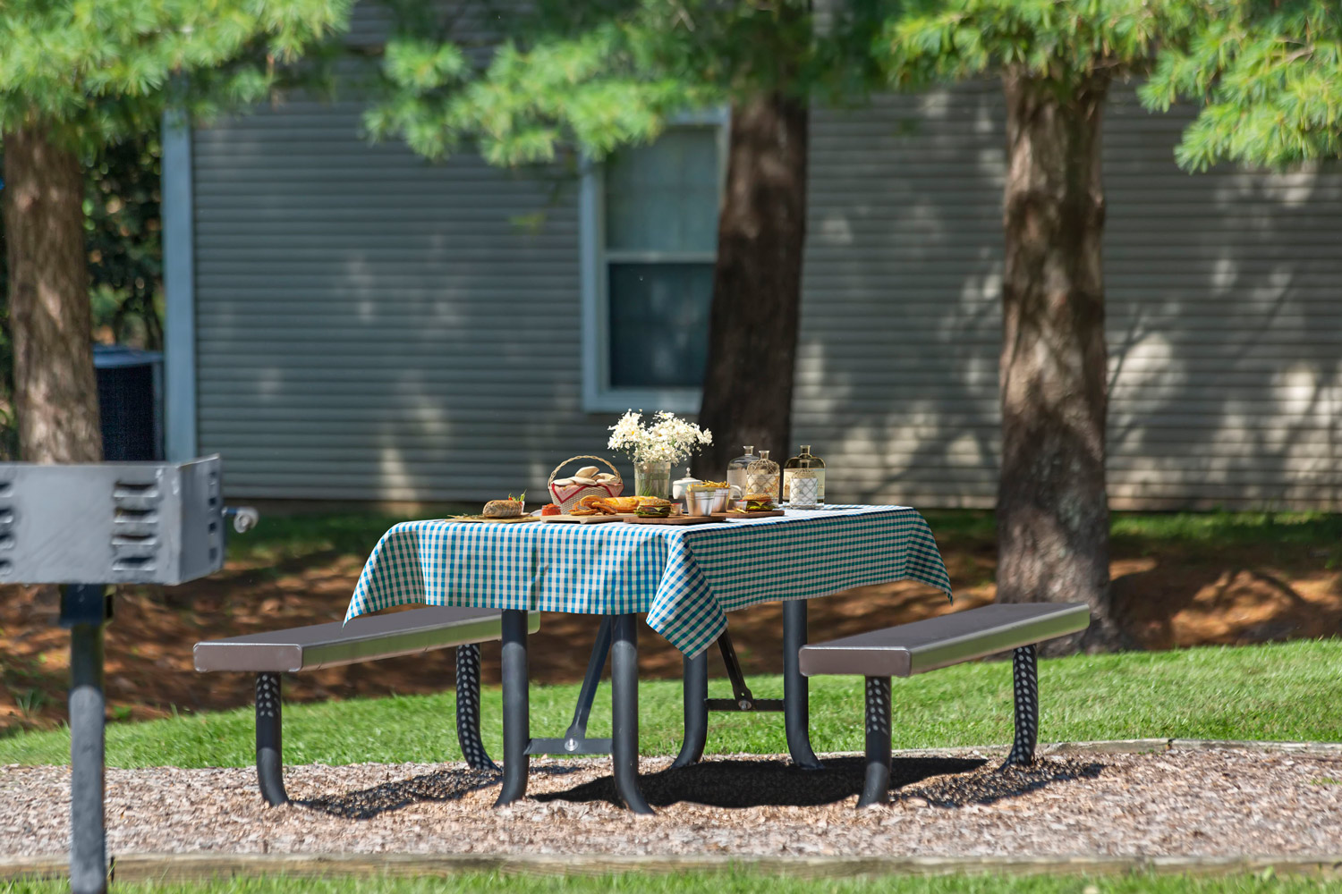 Onsite picnic area with grills at Seneca Club Apartments in Germantown, MD
