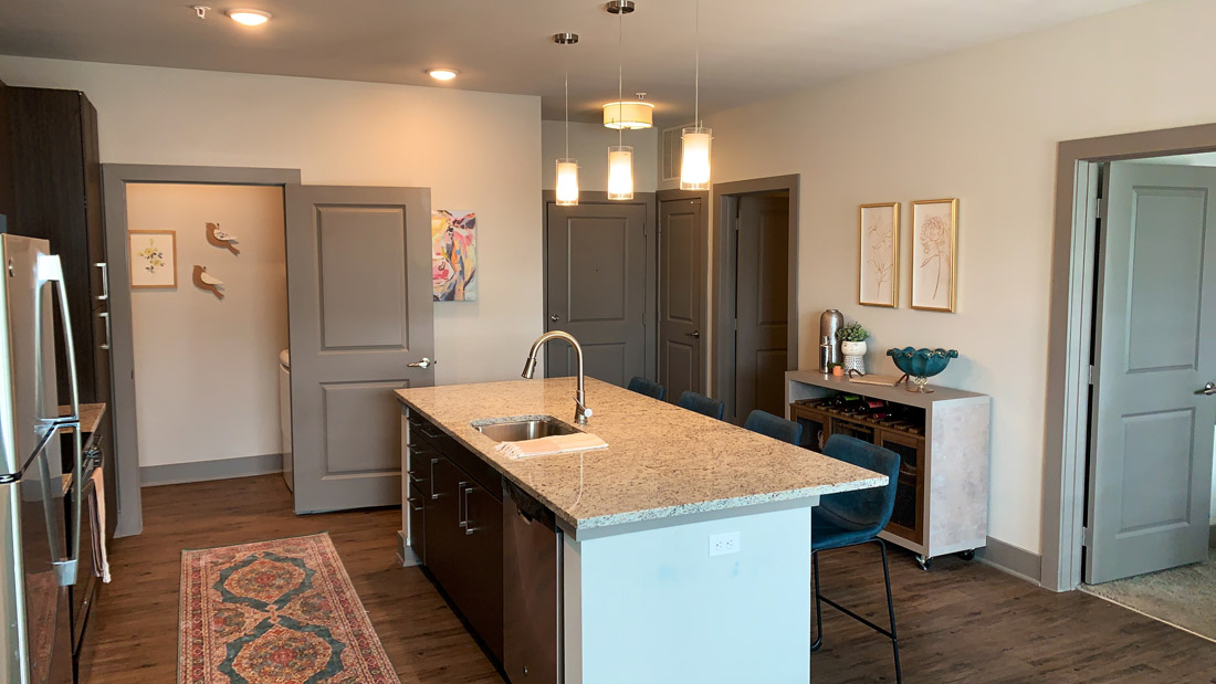 Designer Finishes including granite, wood plank floors, and paint colors
