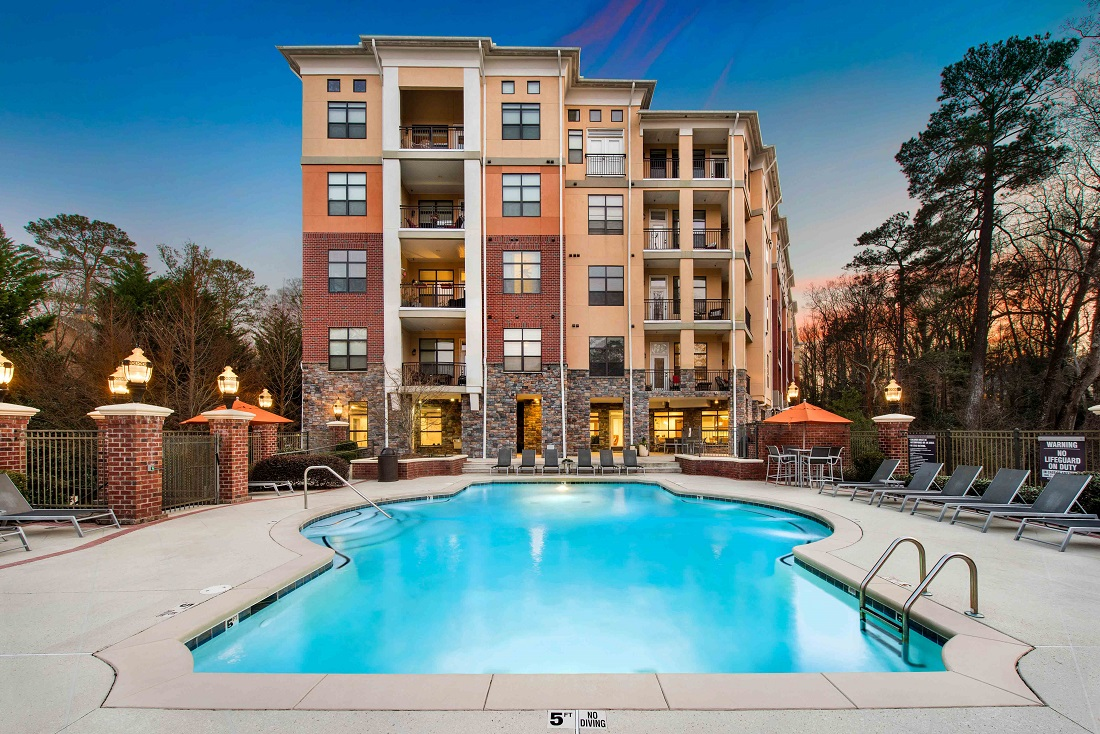Sparkling Pool and Lounge Area at The Sidney at Morningside Apartments in Atlanta, Georgia