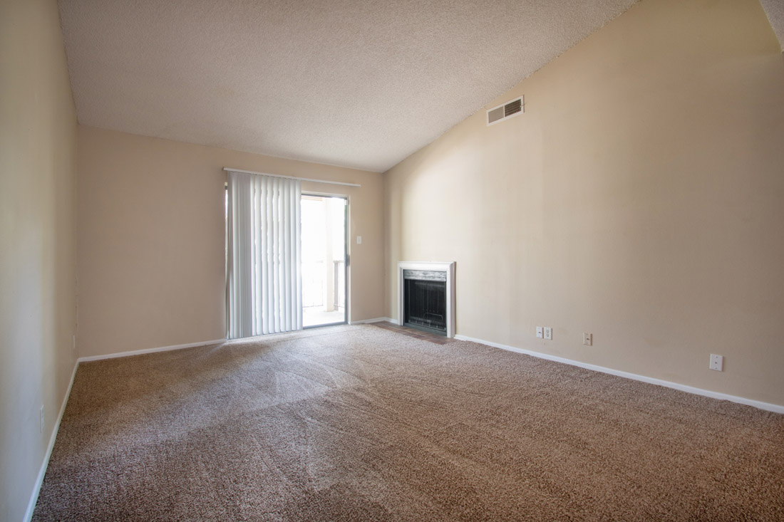 Spacious Living Room with Fireplace at Songbird Apartments in San Antonio, Texas