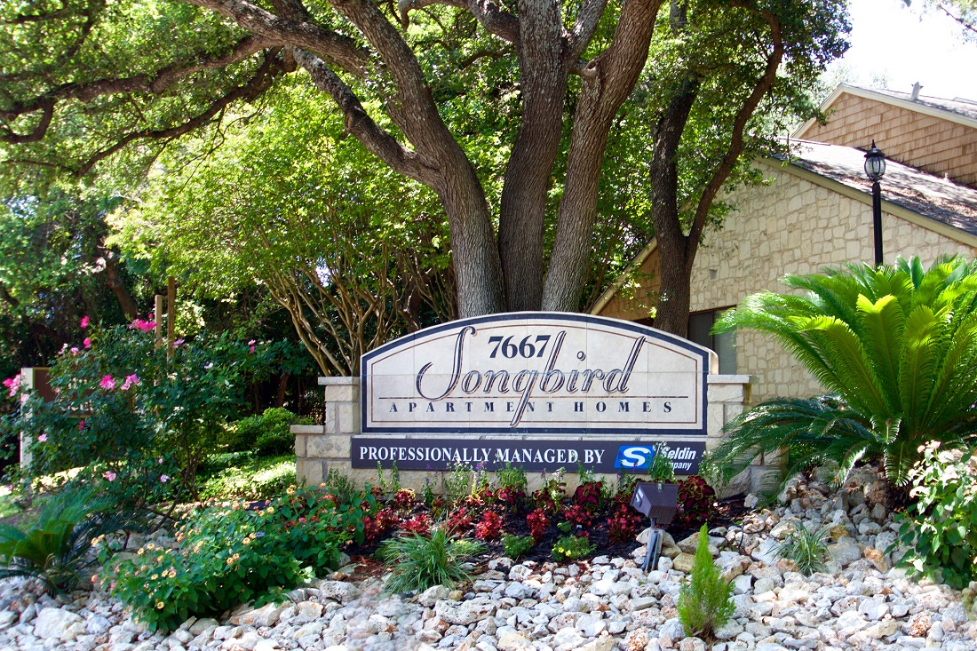 Property Sign at Songbird Apartments in San Antonio, Texas