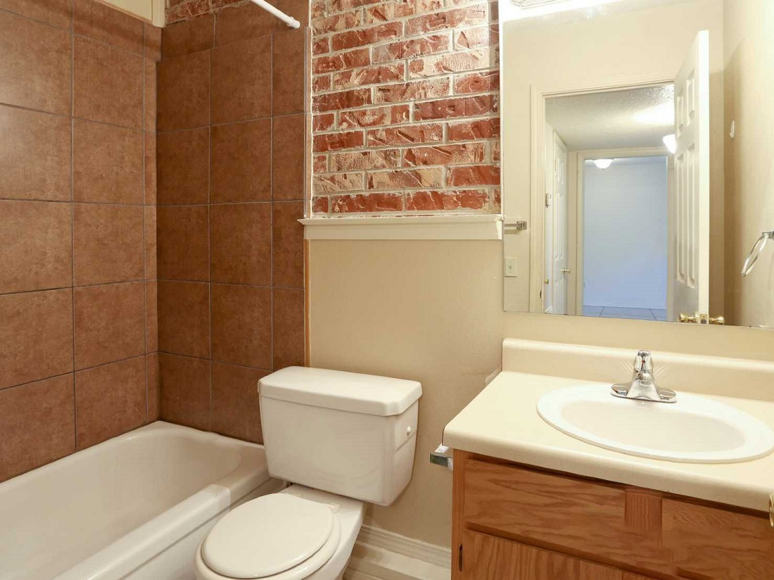 Bathroom with Ample Counter Space at South Creekside Apartments in Fayetteville, AR