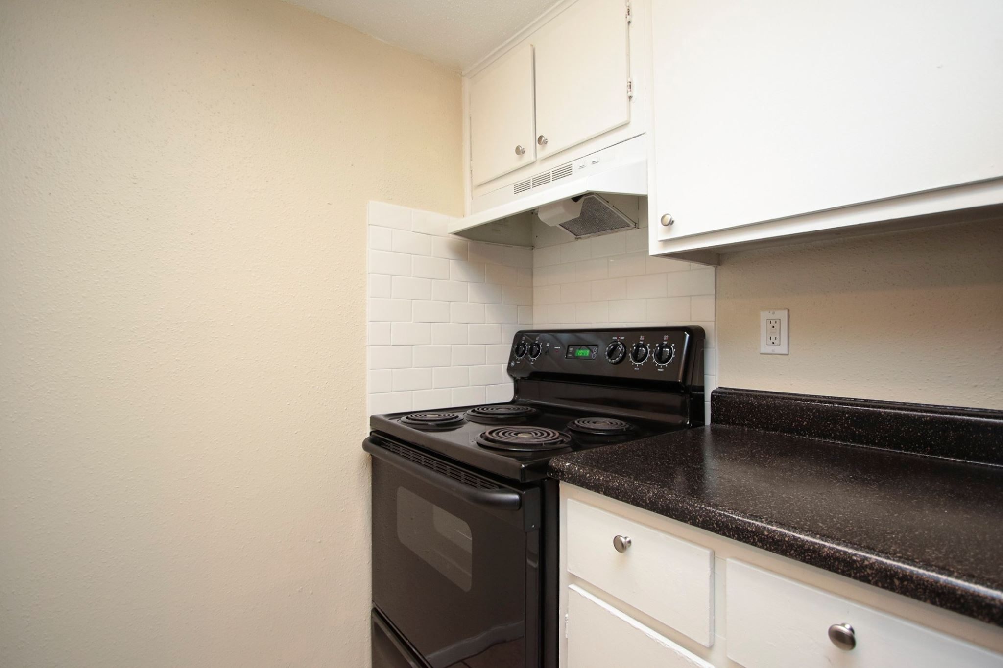 White Cabinetry at Spring Brook Lofts Apartments in Houston, Texas