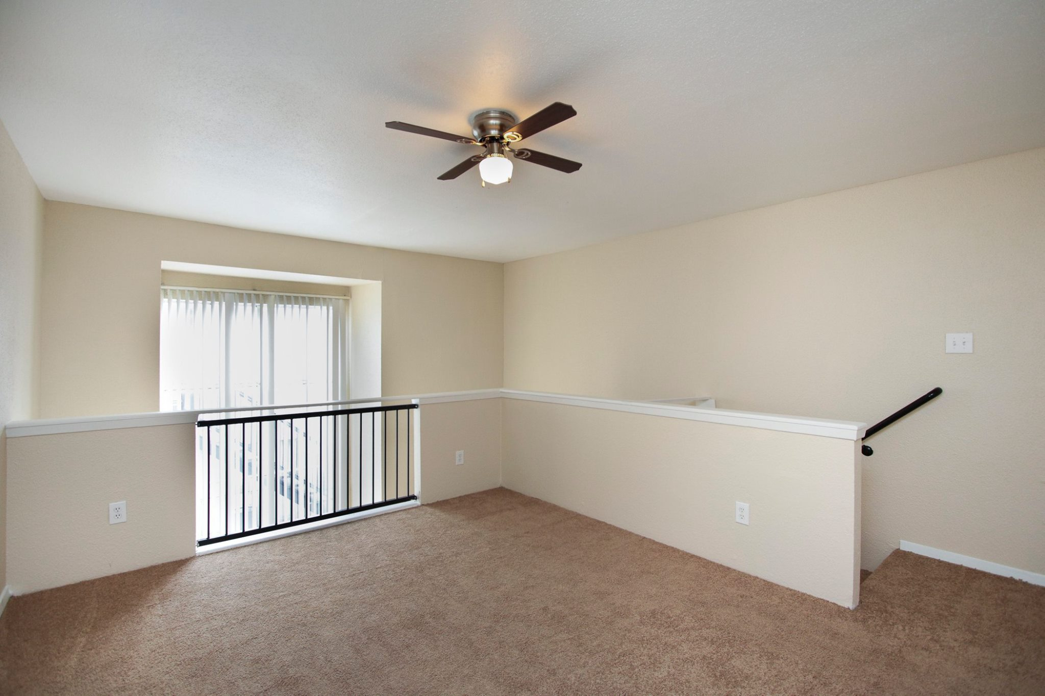 Spacious Bedroom with Ceiling Fans at Spring Brook Lofts Apartments in Houston, Texas