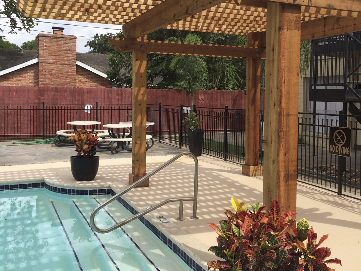 Swimming Pool with Pergola at Spring Brook Lofts Apartments in Houston, Texas