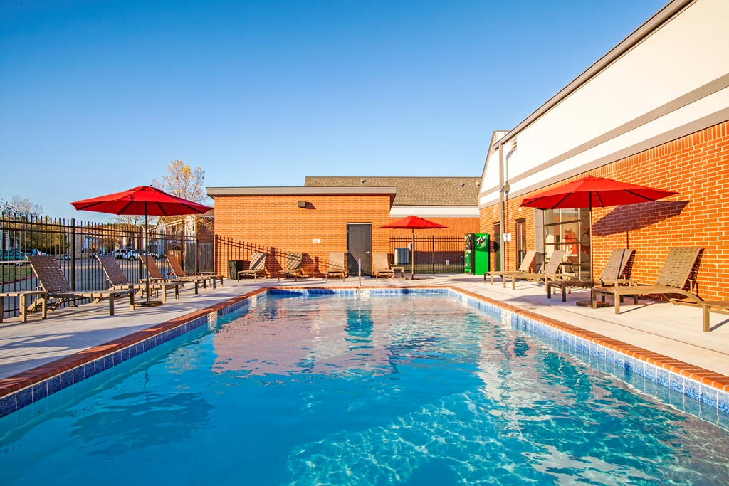 Resort-Style Swimming Pool at The Quarters on Razorback Road Apartments in Fayetteville, AR