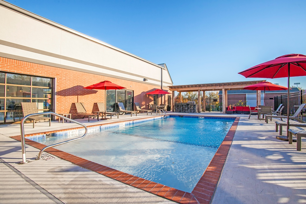 Outdoor Swimming Pool at The Quarters on Razorback Road Apartments in Fayetteville, AR
