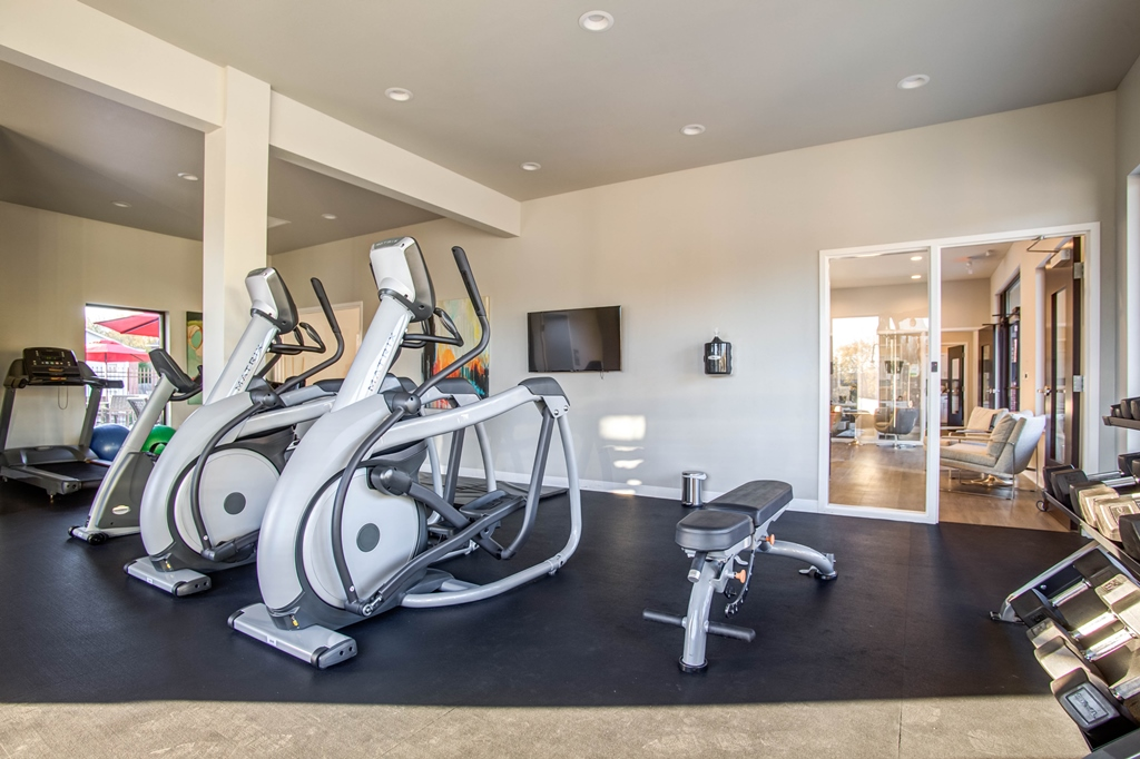 Fully-Equipped Fitness Center at The Quarters on Razorback Road Apartments in Fayetteville, AR