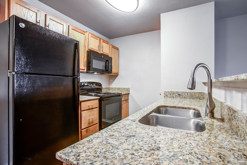 Fully-Equipped Kitchens at The Quarters on Razorback Road Apartments in Fayetteville, AR