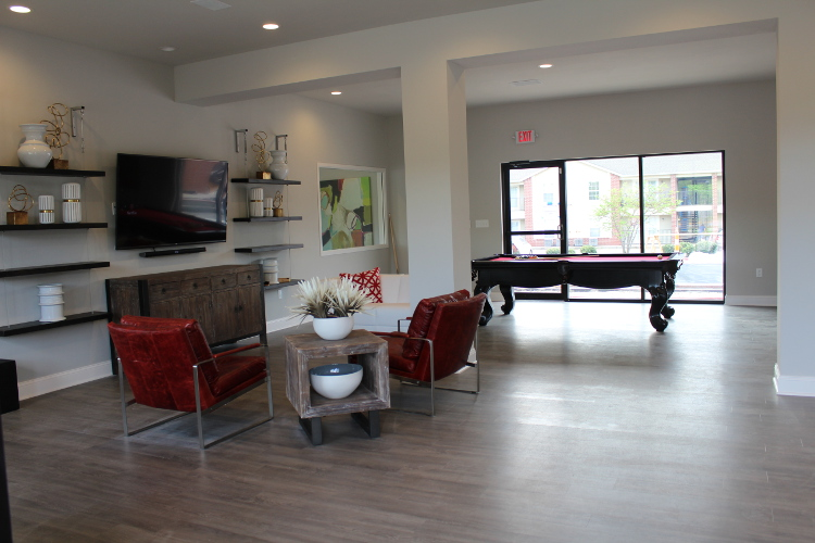 Clubhouse with Billiard Table at The Quarters on Razorback Road Apartments in Fayetteville, AR