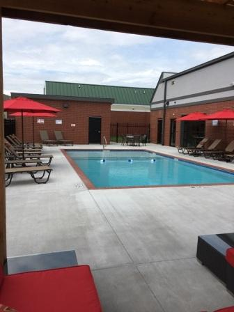 Sparkling Pool at The Quarters on Razorback Road Apartments in Fayetteville, AR