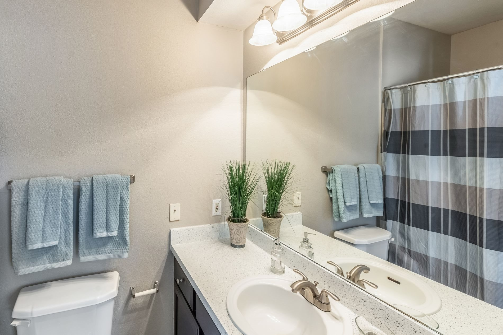 Bathroom with Vanity at Station 3700 Apartment Homes in Euless, Texas