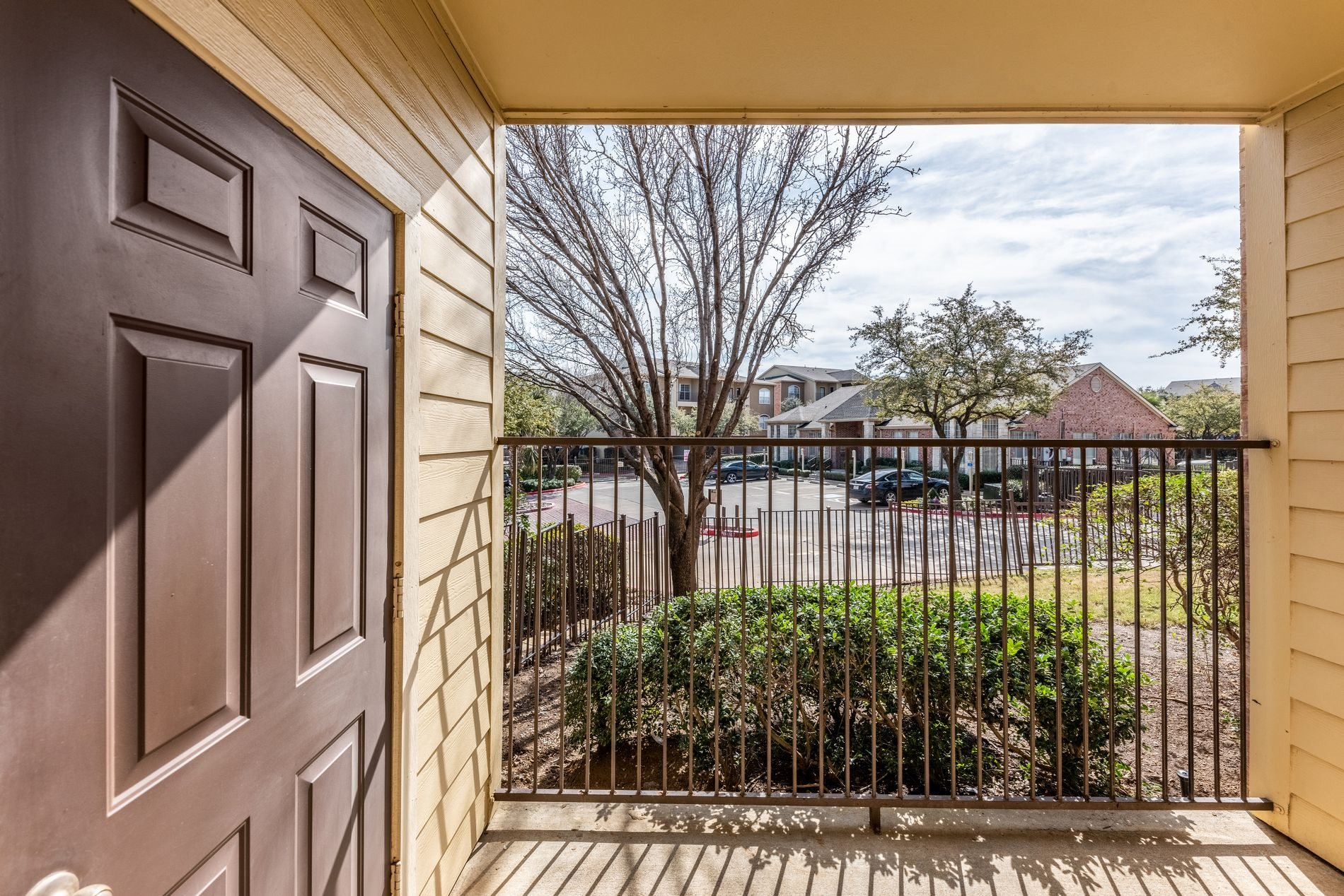 Patio or Balcony at Station 3700 Apartment Homes in Euless, Texas