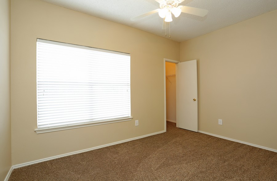 Bedroom at the Stonebrook Village Apartments in Frisco, TX