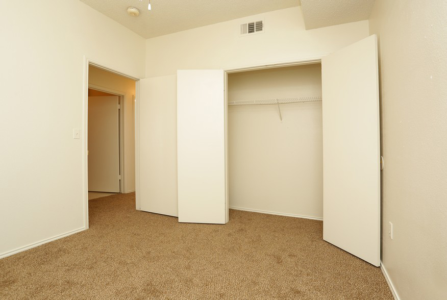 Bedroom and Closet at the Stonebrook Village Apartments in Frisco, TX