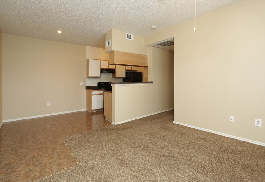 Kitchen and Living Room at the Stonebrook Village Apartments in Frisco, TX