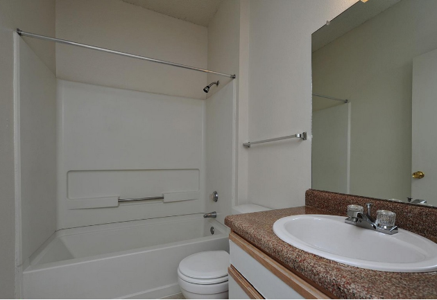 Bathroom at the Stonebrook Village Apartments in Frisco, TX