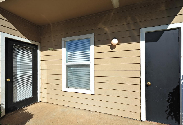 Patio and Storage at the Stonebrook Village Apartments in Frisco, TX