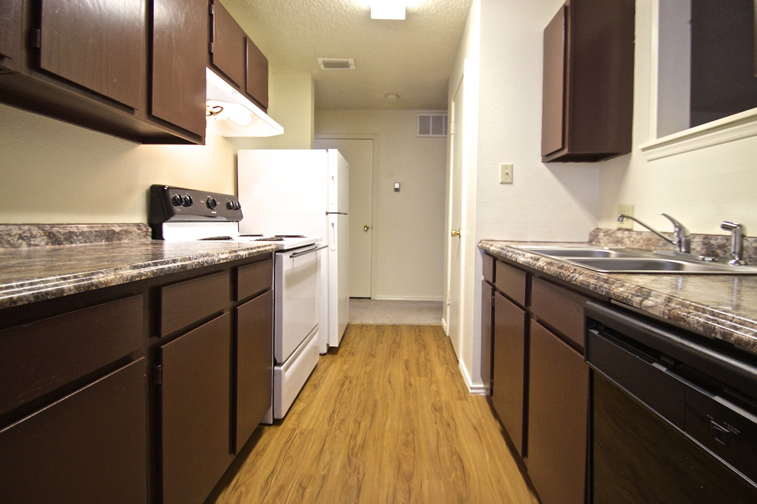 Ample Kitchen Cabinet Storage at Stonegate Apartments in Abilene, TX