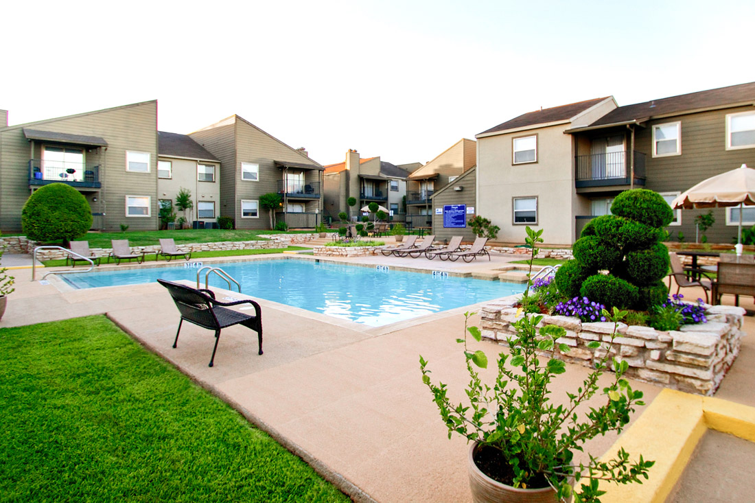 Pool Lounge Area at Stonegate Apartments in Abilene, TX