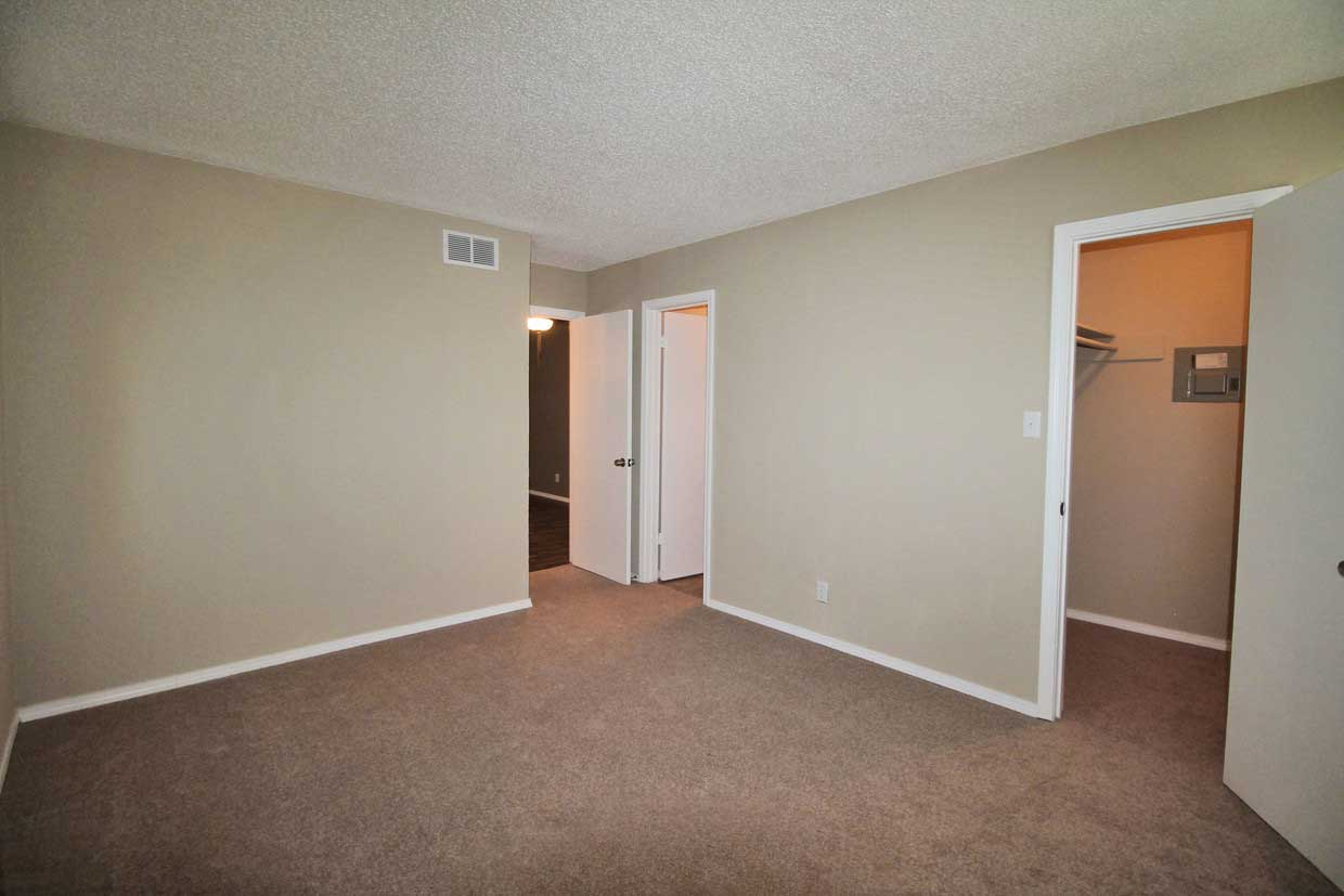 Bedrooms with Attached Closets at Sungate Apartments in San Antonio, Texas