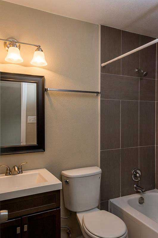 Bathtub and Shower at Sungate Apartments in San Antonio, Texas