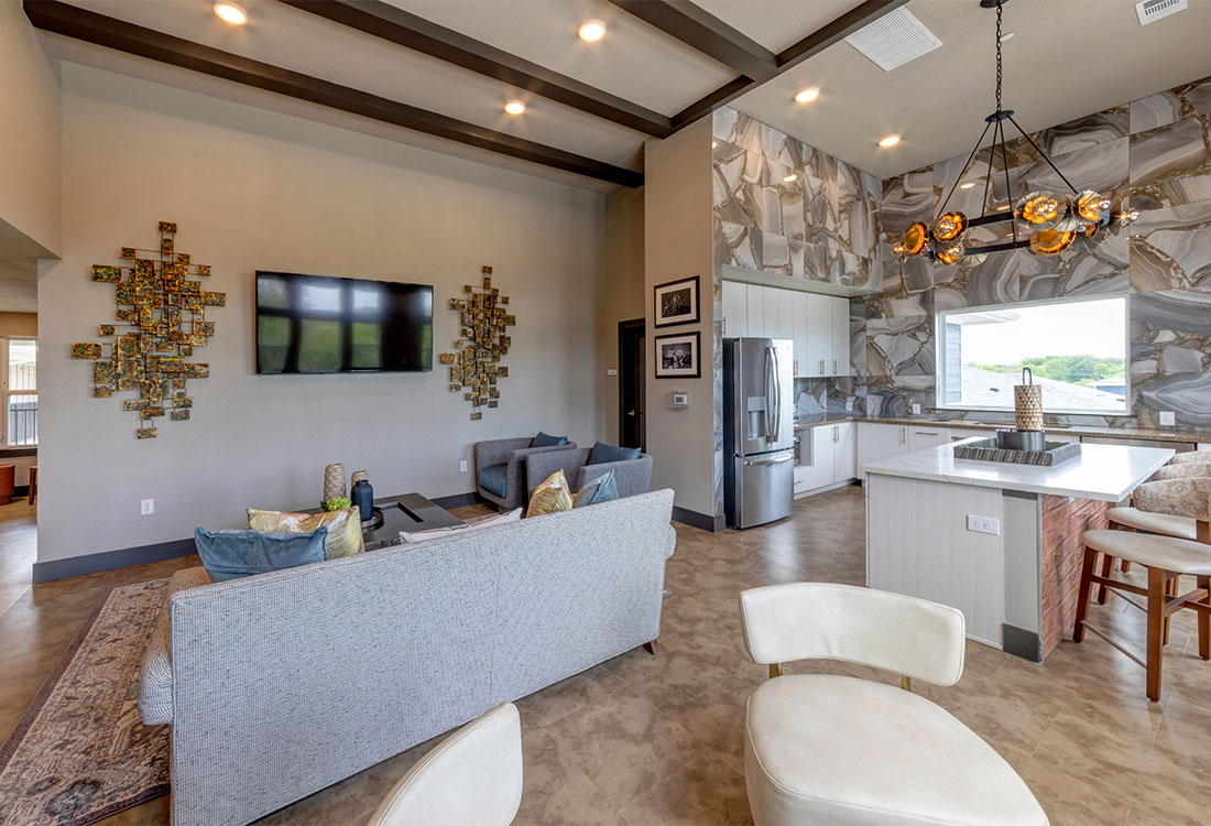 Gorgeous Community Area with Kitchen at Sunset at Fash Place Apartments in Fort Worth, TX