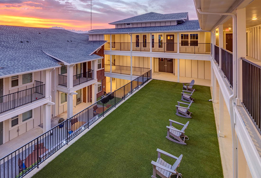 Beautiful Community Patios at Sunset at Fash Place Apartments in Fort Worth, TX