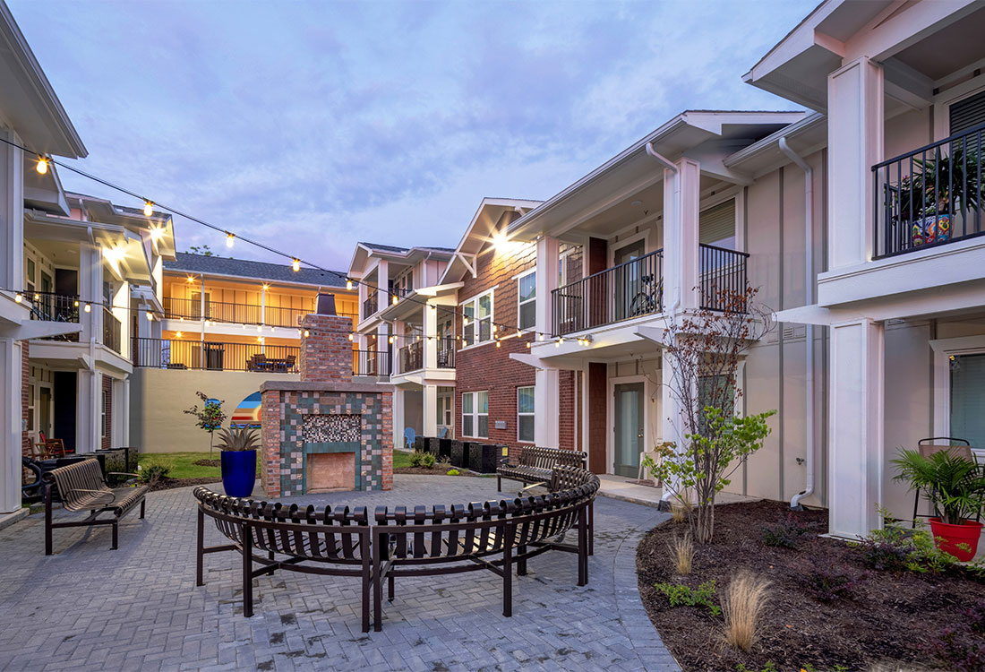 Beautiful Community Patios with Fireplace at Sunset at Fash Place Apartments in Fort Worth, TX