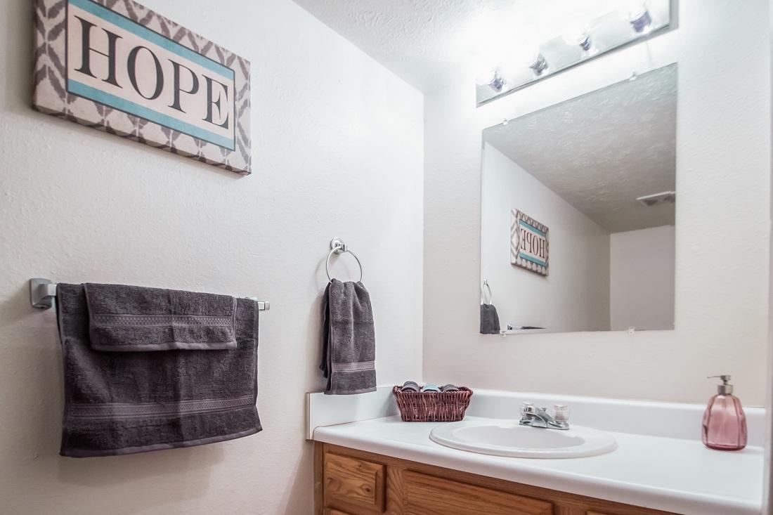 Bathroom with Vanity Lighting at Sunset Ridge Apartments in Omaha, NE