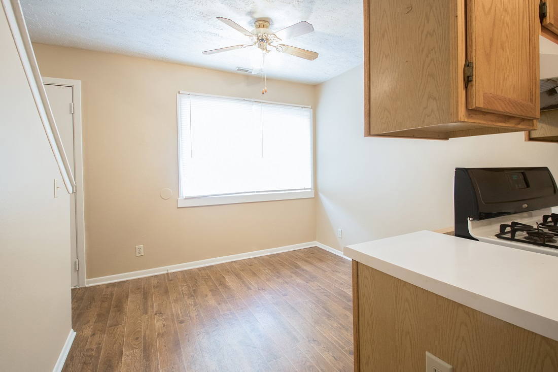Spacious Kitchen and Dining Area at Sunset Ridge Apartments in Omaha, NE