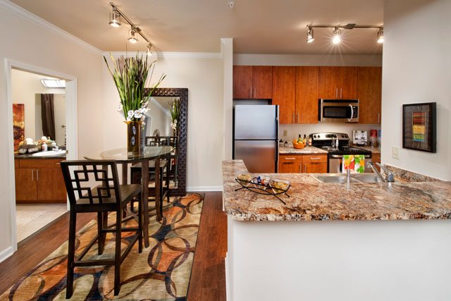 Dining and Kitchen Area at The Oxford at Tech Ridge Apartments in Austin, TX