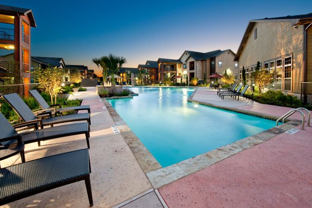 Poolside Lounge at The Oxford at Tech Ridge Apartments in Austin, TX
